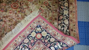 Color fading on artificial silk rug.
